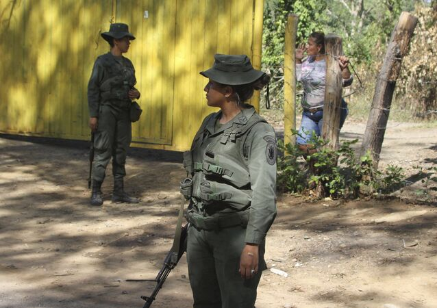 Venezuelan Bolivarian soldiers stand at a checkpoint near Urena, Tachira state, Venezuela, on the border with Colombia.