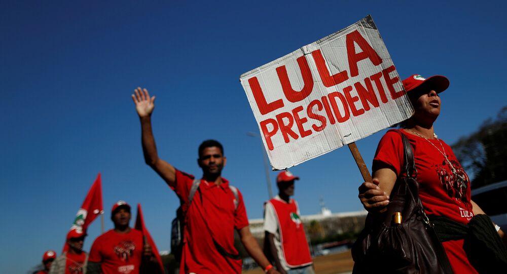 Brazil's former President Luiz Inacio Lula da Silva's supporters walk during the Free Lula March in Brasilia, Brazil, August 14, 2018.