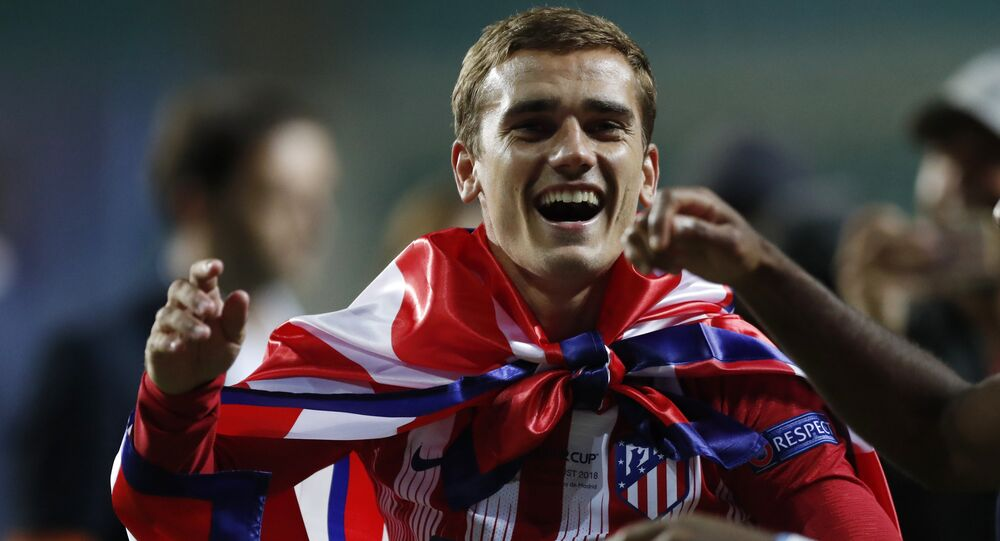 Atletico's Antoine Griezmann celebrates after winning the UEFA Super Cup final soccer match between Real Madrid and Atletico Madrid at the Lillekula Stadium in Tallinn, Estonia, Wednesday, Aug. 15, 2018