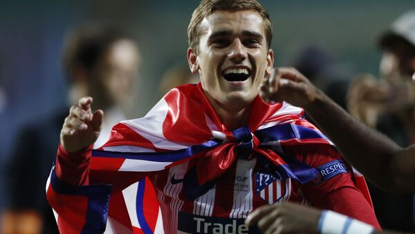 Atletico's Antoine Griezmann celebrates after winning the UEFA Super Cup final soccer match between Real Madrid and Atletico Madrid at the Lillekula Stadium in Tallinn, Estonia, Wednesday, Aug. 15, 2018 - Sputnik International