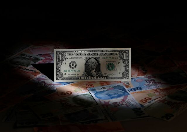 A U.S. dollar banknote is seen on top of Turkish lira banknotes in this picture illustration in Istanbul, Turkey August 14, 2018