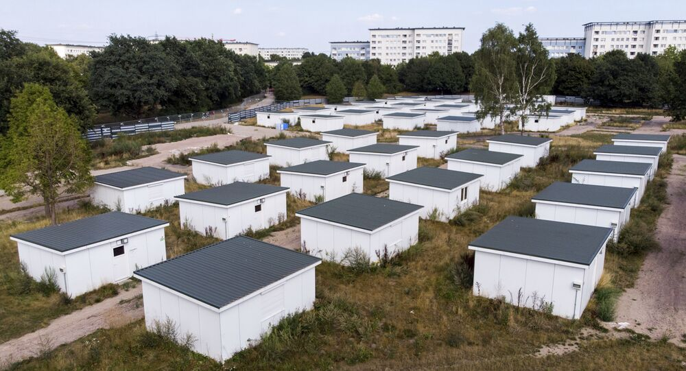 In this Aug. 16, 2018 photo houses originally built for refugees sit on the site of a former refugee center in Hamburg, Germany