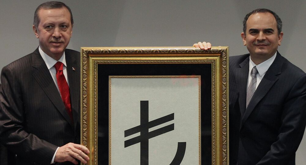 Turkish Prime Minister Recep Tayyip Erdogan, left, and Central Bank Governor Erdem Basci show the symbol for the national currency, the Turkish lira, in Ankara, Turkey, Thursday, March 1, 2012