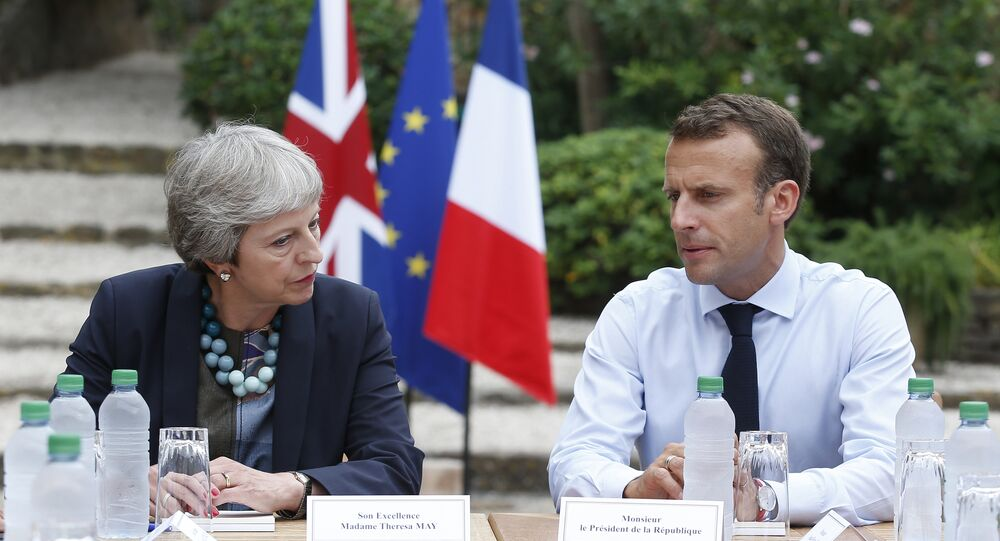 French President Emmanuel Macron, right, meets with British Prime Minister Theresa May to discuss Brexit issues at the Fort de Bregancon in Bornes-les-Mimosas, southern France, Friday Aug. 3, 2018