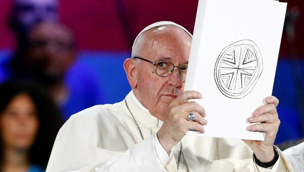 Pope Francis holds the Book of the Gospels as he meets Italian youth at the ancient Circo Massimo in Rome, Italy August 11, 2018 - Sputnik International