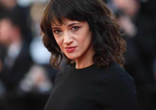 (FILES) In this file photo taken on May 19, 2018 Italian actress Asia Argento arrives for the closing ceremony and the screening of the film The Man Who Killed Don Quixote at the 71st edition of the Cannes Film Festival in Cannes, southern France