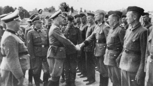 This 1942 photo provided by the the public prosecutor's office in Hamburg via the United States Holocaust Memorial Museum, shows Heinrich Himmler, center left, shaking hands with new guard recruits at the Trawniki concentration camp in Nazi occupied Poland. - Sputnik International
