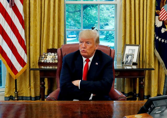 US President Donald Trump reacts to a question during an interview with Reuters in the Oval Office of the White House in Washington, U.S. August 20, 2018.