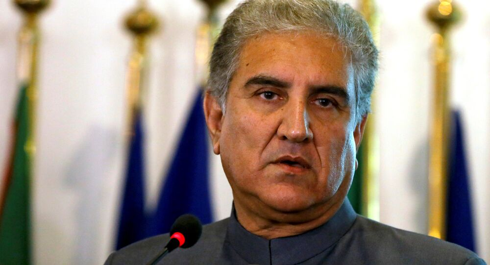 Pakistan's new Foreign Minister Shah Mehmood Qureshi listens during a news conference at the Foreign Ministry in Islamabad, Pakistan August 20, 2018