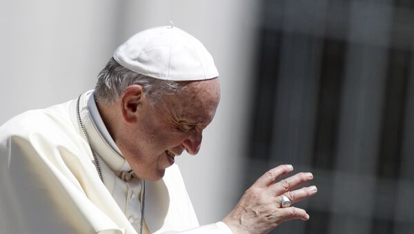 Pope Francis waves to faithful as he leaves at the end of his weekly general audience, in St. Peter's Square, at the Vatican, Wednesday, June 13, 2018 - Sputnik International