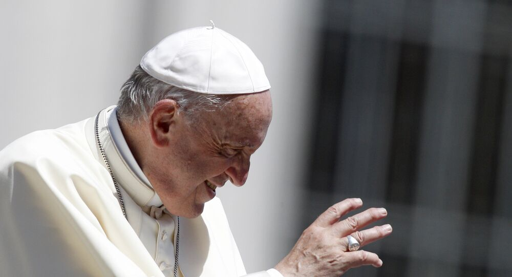 Pope Francis waves to faithful as he leaves at the end of his weekly general audience in St. Peter's Square, at the Vatican, 13 June 2018
