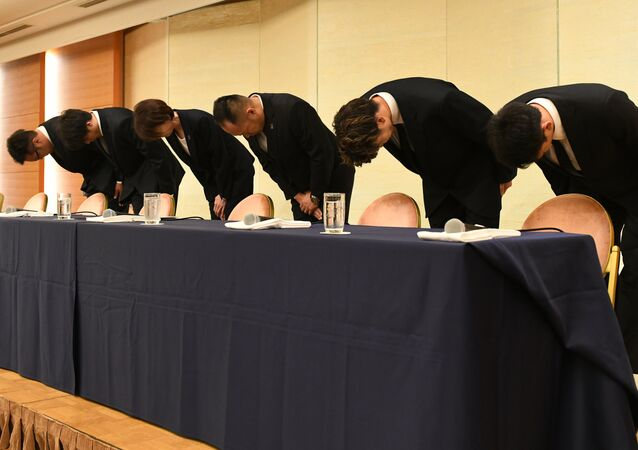 L-R: Japan's basketball players, Yuya Nagayoshi, Takuya Hashimoto, head of the Japan Basketball Association Yuko Mitsuya, technical chairperson Tomoya Higashino, Takuma Sato, Keita Imamura, bow at the beginning of a press conference in Tokyo on August 20, 2018