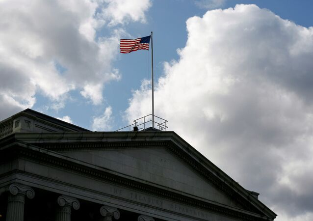 The United States flag flies atop the U.S. Treasury Department in Washington November 18, 2008