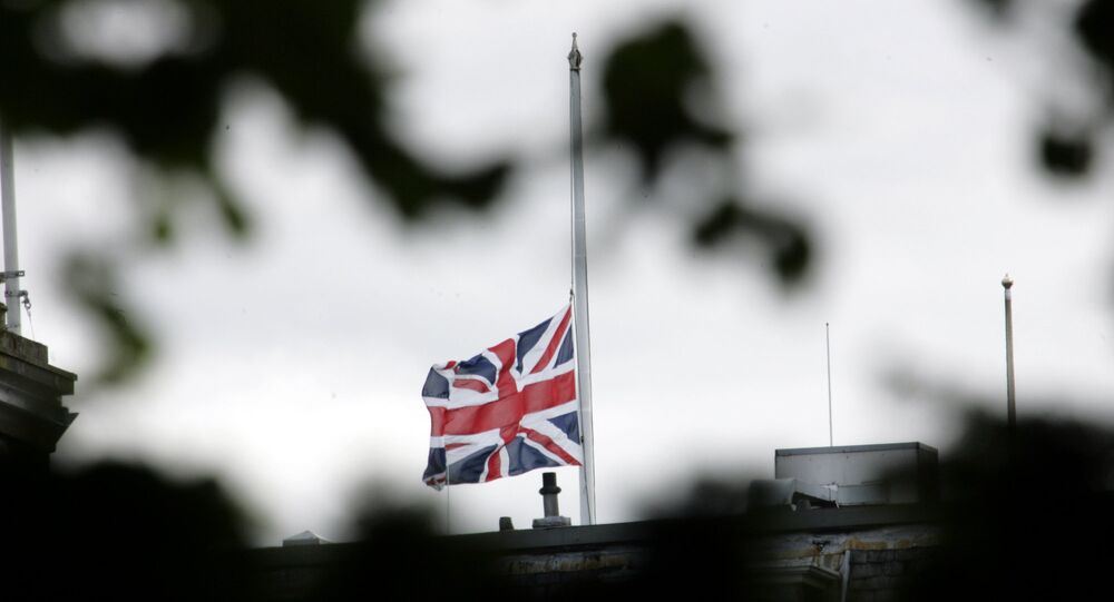 The British flag is seen at half mast.