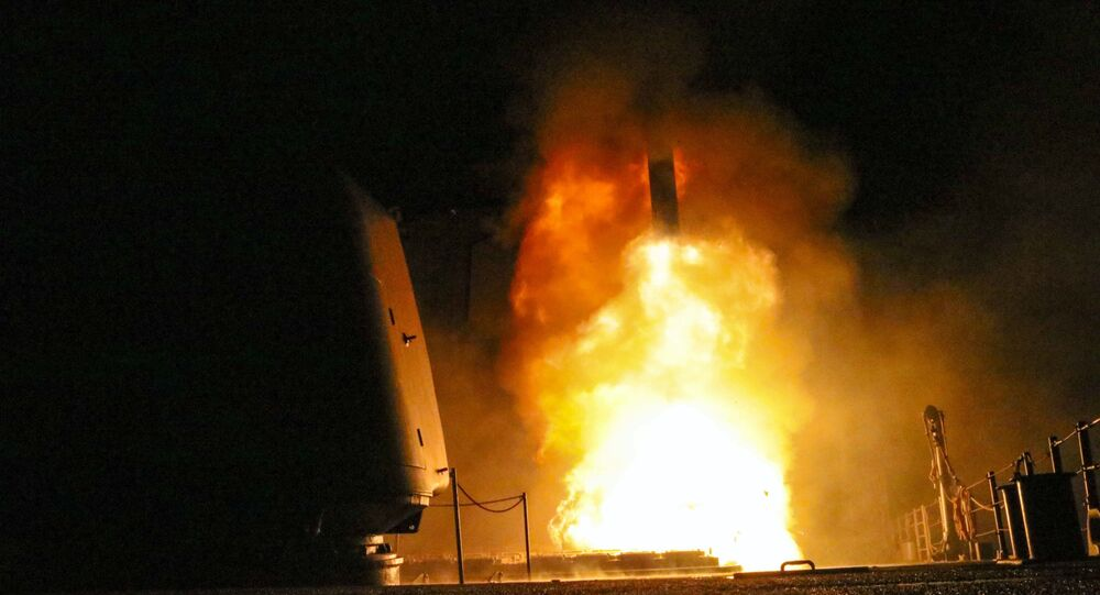 In this image provided by the U.S. Navy, the guided-missile cruiser USS Monterey (CG 61) fires a Tomahawk land attack missile Saturday, April 14, 2018, as part of the military response to Syria's alleged use of chemical weapons on April 7.