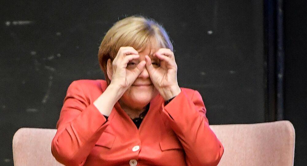 German Chancellor Angela Merkel With 'Binoculars'