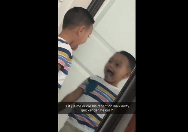 Strange Reflection of Boy in a Mirror. 2018