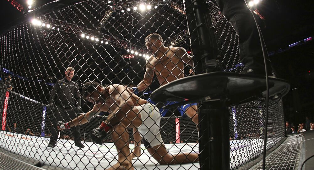 Eryk Anders knocks out Rafael Natal during their mixed martial arts bout at UFC on Fox 25, Saturday, July 22, 2017, in New York. Anders won via 1st round KO