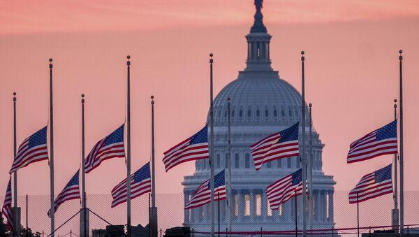 Flags flying a half-staff in honor of Sen. John McCain, R-Ariz., frame the U.S. Capital at daybreak in Washington, Sunday, Aug. 26, 2018. - Sputnik International