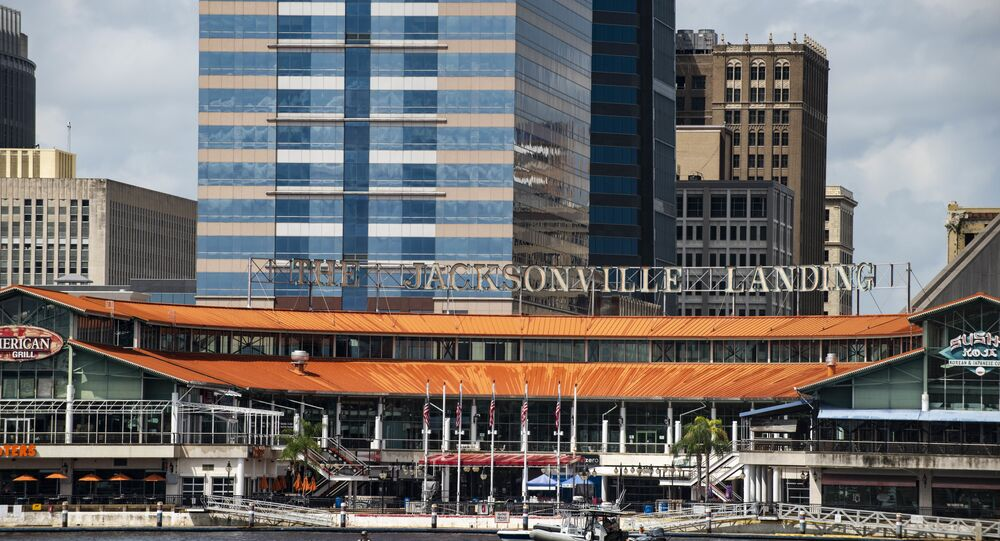 The coast guard patrols the St John's river outside of the Jacksonville Landing in Jacksonville, Fla., Sunday, Aug. 26, 2018. Florida authorities are reporting multiple fatalities after a mass shooting at the riverfront mall in Jacksonville that was hosting a video game tournament