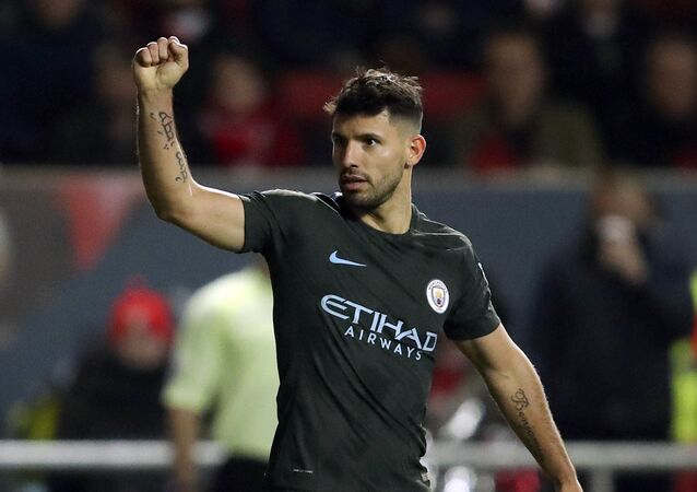 Manchester City's Sergio Aguero celebrates scoring his side's second goal of the game during the English League Cup semi final, second leg match against Bristol City at Ashton Gate, Bristol, England, Tuesday, Jan. 23, 2018