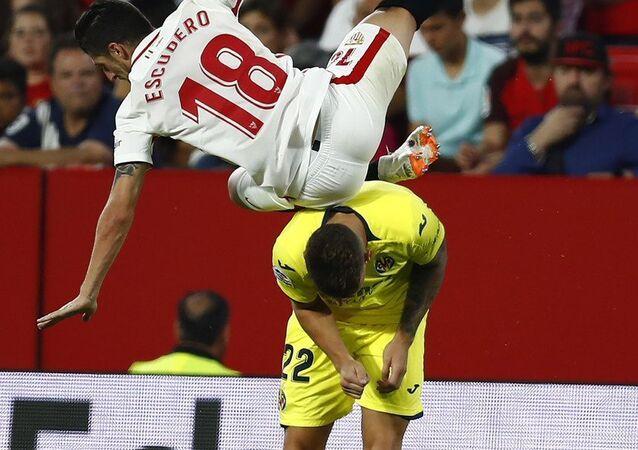 Segio Escudero is seen falling down after colliding with Villareal footballer Daniel Raba