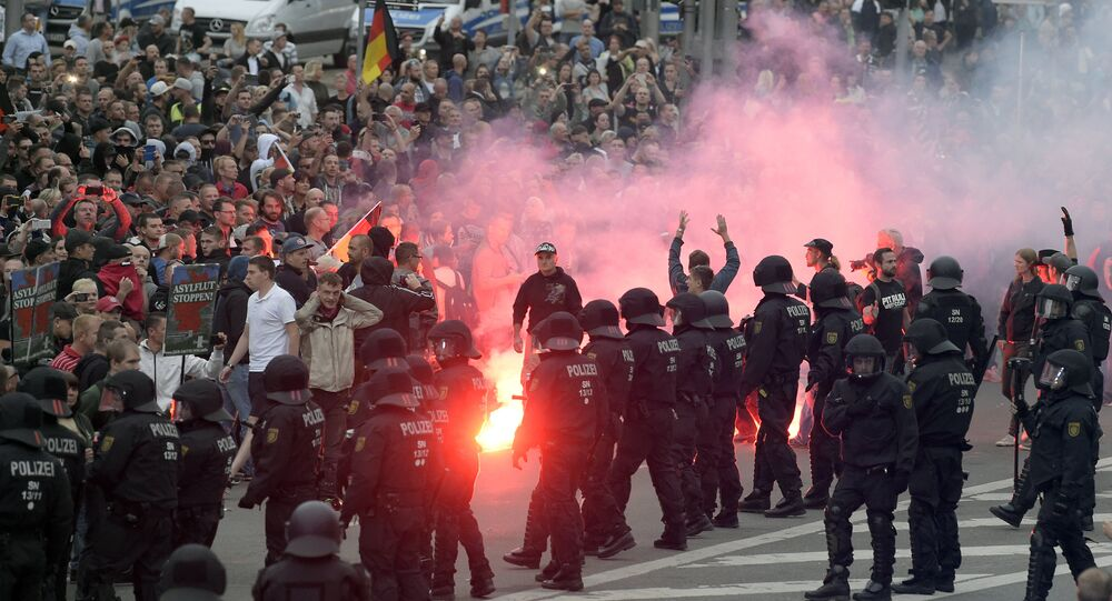 Protesters light fireworks during a far-right demonstration in Chemnitz, Germany, Monday, Aug. 27, 2018 after a man has died and two others were injured in an altercation between several people of various nationalities in the eastern German city of Chemnitz on Sunday
