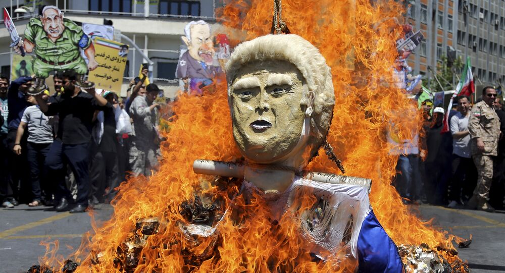 In this Friday, June 8, 2018, photo, an effigy of the U.S. President Donald Trump is set on fire during the annual anti-Israeli Al-Quds, Jerusalem, Day rally in Tehran, Iran