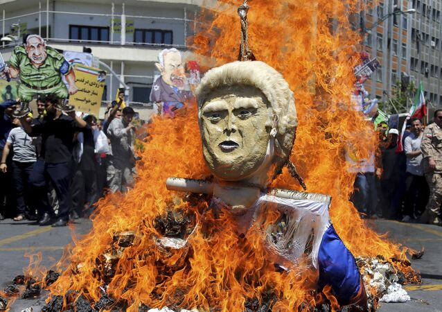 "In this Friday, June 8, 2018, photo, an effigy of the U.S. President Donald Trump is set on fire during the annual anti-Israeli Al-Quds, Jerusalem, Day rally in Tehran, Iran. For Iran, the so-called ""Axis of Evil"" has become a lonely party of one as President Donald Trump prepares for direct talks with North Korea. With Saddam Hussein overthrown and Kim Jong Un now preparing for planned meeting in Singapore with Trump, Iran remains the last renegade among former President George W. Bush's grouping of nations opposed to the U.S. It also comes after Trump pulled out of the nuclear deal, worsening Iran's already-anemic economy"