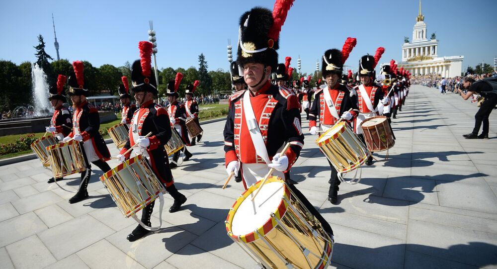The corps of Old Grenadiers of Geneva, Switzerland takes part in the procession of the participants in the international military music festival, Spasskaya Tower, at VDNKh