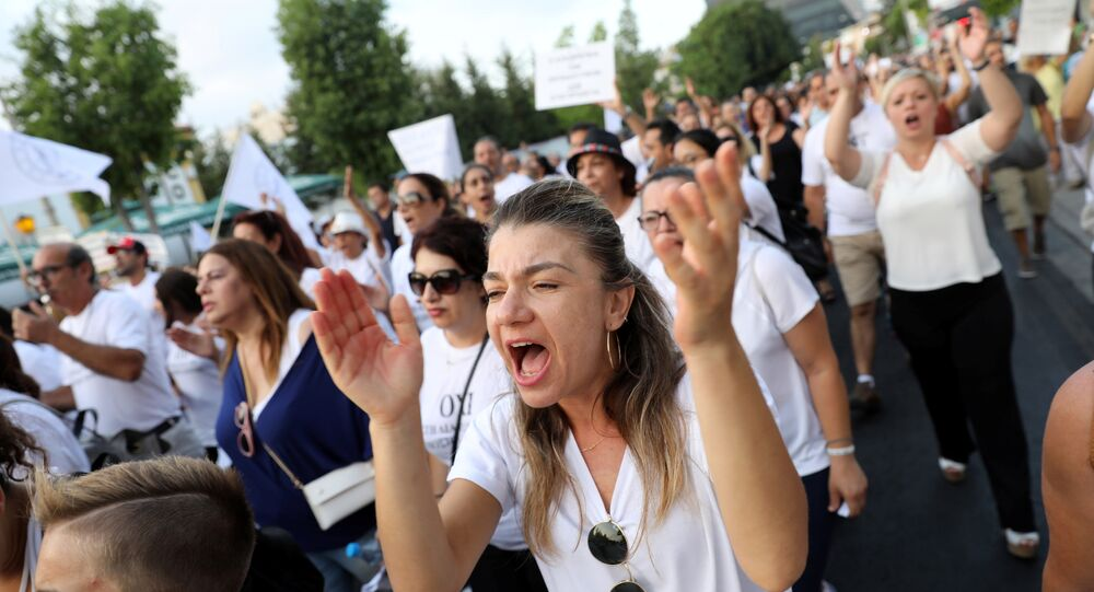 Public school teachers shout slogans during a protest against educational reforms in Nicosia, Cyprus August 28, 2018