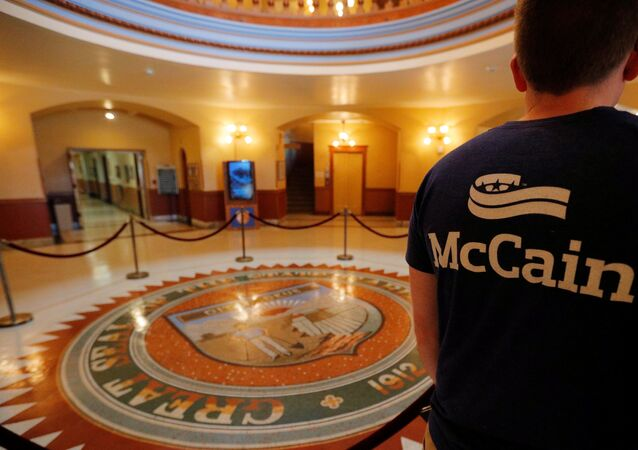 An event organizer wears a McCain t-shirt in the Rotunda of the Arizona State Capitol, where the late U.S. Senator John McCain will lie in state, in Phoenix, Arizona, U.S., August 27, 2018