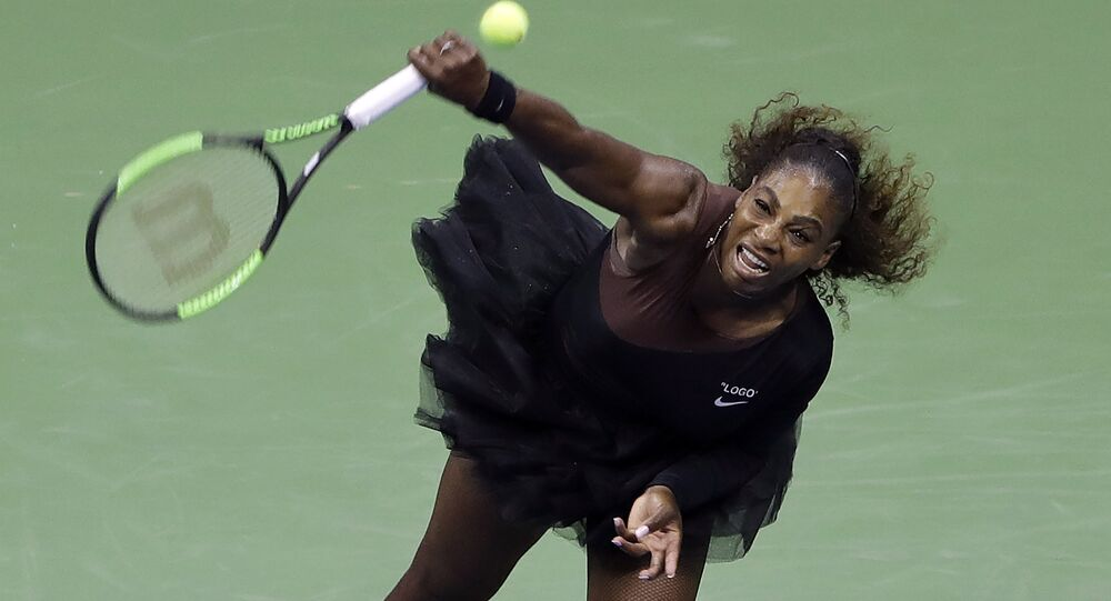 Serena Williams, of the United States, serves to Magda Linette, of Poland, during the first round of the U.S. Open tennis tournament, Monday, Aug. 27, 2018, in New York