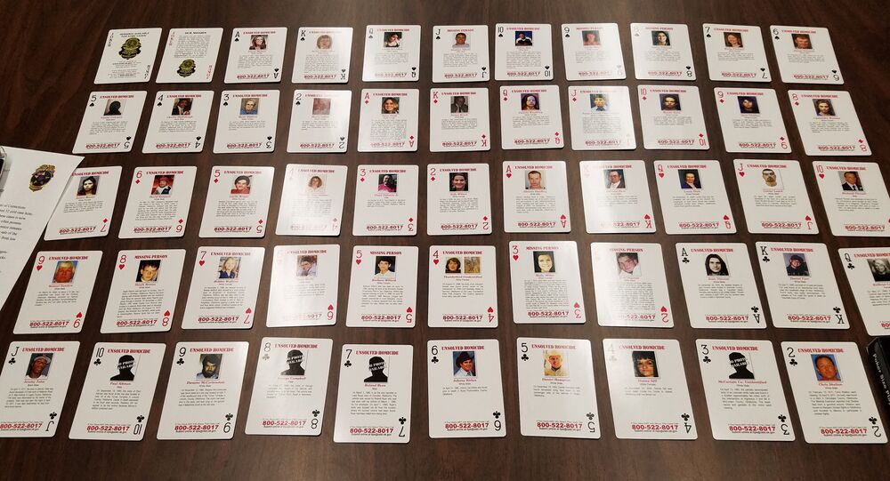 Playing cards featuring unsolved and unidentified homicides or missing person cases are displayed at Oklahoma State Bureau of Investigation headquarters in Oklahoma City, Wednesday, Oct. 11, 2017