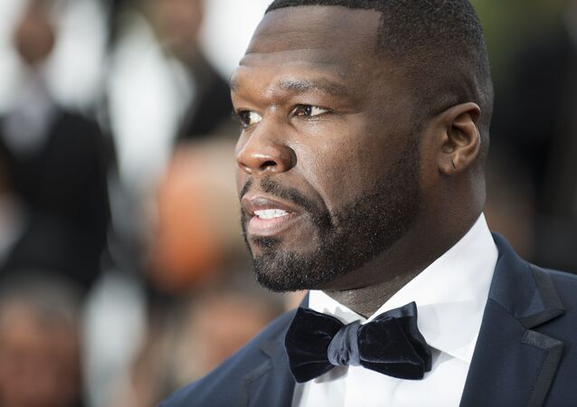 Singer Curtis 50 Cent Jackson poses for photographers upon arrival at the premiere of the film 'Solo: A Star Wars Story' at the 71st international film festival, Cannes, southern France, Tuesday, May 15, 2018