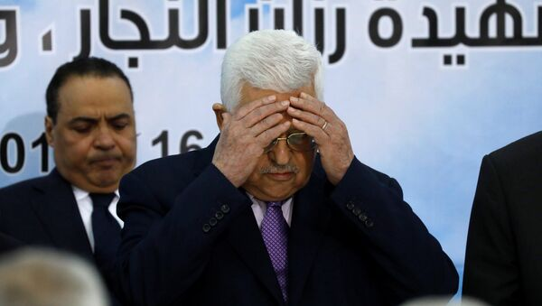 Palestinian President Mahmoud Abbas prays at the opening of the Palestinian Central Council meeting, in Ramallah, in the occupied West Bank August 15, 2018 - Sputnik International