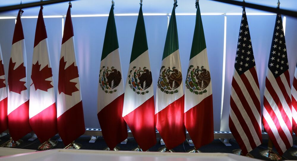 National flags representing Canada, Mexico, and the US are lit by stage lights at the North American Free Trade Agreement, NAFTA, renegotiations, in Mexico City, Tuesday, Sept. 5, 2017.