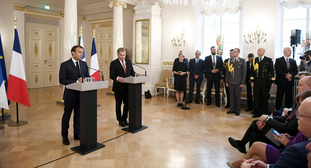 French President Emmanuel Macron and Finland's President Sauli Niinisto speak during a news conference at the Presidential Palace in Helsinki, Finland August 30, 2018