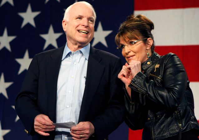 U.S. Senator John McCain (R-AZ) and former Alaska Governor and vice presidential candidate Sarah Palin acknowledge the crowd during a campaign rally for McCain at the Pima County Fairgrounds in Tucson, Arizona March 26, 2010