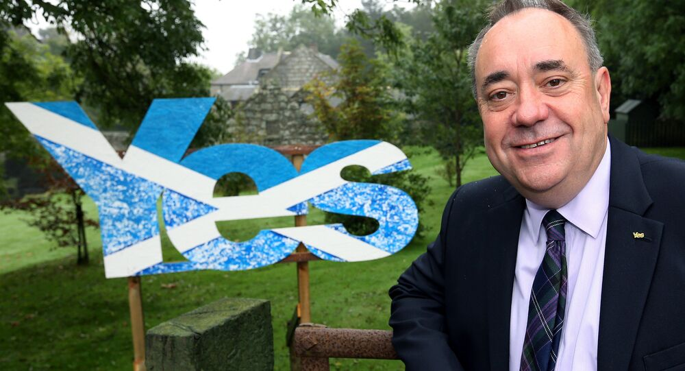 Scotland's then First Minister Alex Salmond poses for photographs outside his home in Strichen, Scotland, Thursday, Sept. 18, 2014.