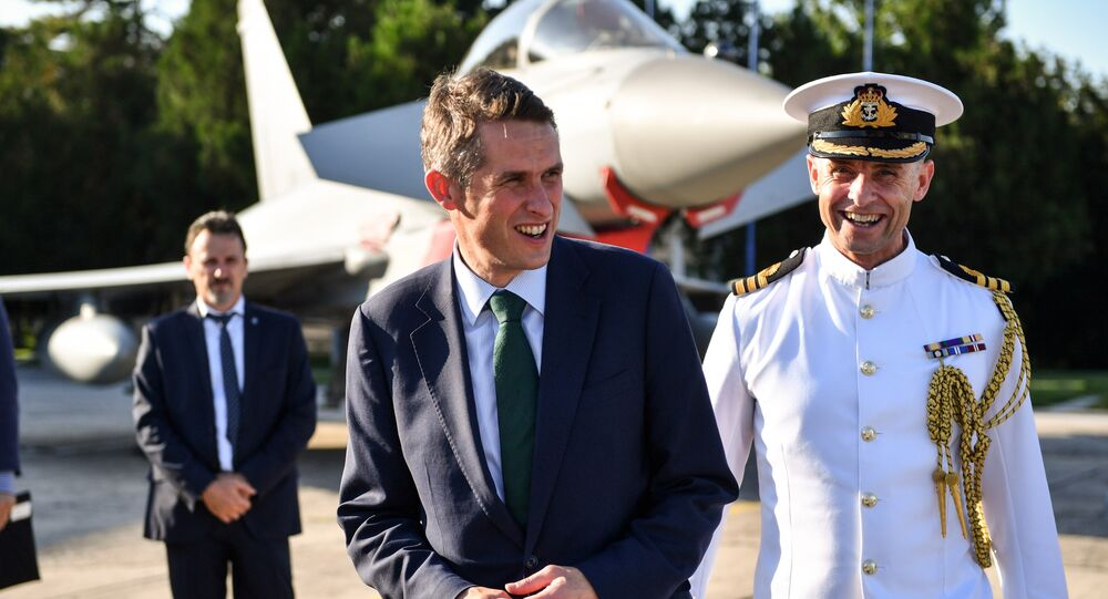 British Defense Minister Gavin Williamson (L) meets with the British pilots and technical staff serving the four British Air Force Typhoons and the Romanian military personnel at Mihail Kogalniceanu 57 Air Base near Constanta, Romania on August 2, 2018.