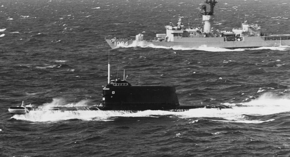A US Navy destroyer shadows a Soviet submarine in the late 1970s in European waters. A similar Soviet submarine sank a decade earlier off Hawaii