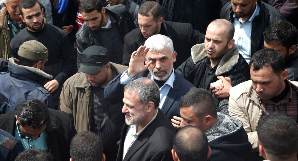 Islamist Hamas movement leader Yahya Sinwar (C) takes part in a tent city protest near the border with Israel east of Jabalia in the northern Gaza strip on March 30, 2018 to commemorate Land Day