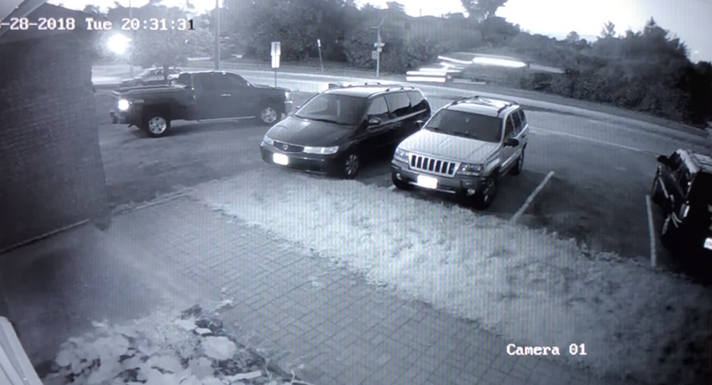Surveillance camera captures the moment a Model S Tesla goes airborne, crashing into a tree near a school parking lot.