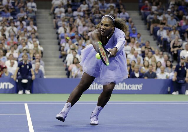 Serena Williams returns a shot to Carina Witthoeft, of Germany, during the second round of the U.S. Open tennis tournament, Wednesday, Aug. 29, 2018, in New York.