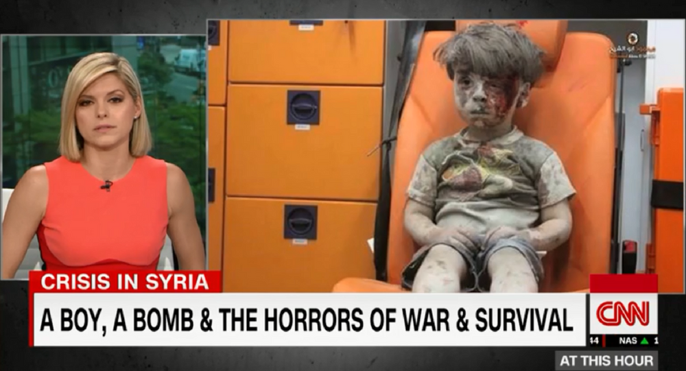 CNN anchor Kate Bolduan chokes up after Omran Daqneesh, 5, was injured in an alleged airstrike. The boy's father came out in support of Assad and criticized rebel groups for using his son's image as propaganda in June 2017.