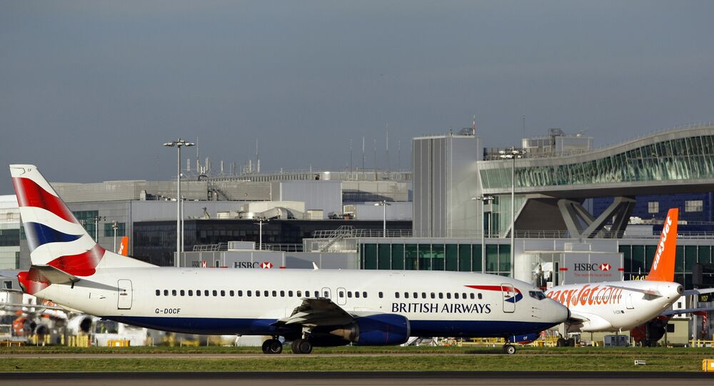 A British Airways passenger jet taxis along the apron at Gatwick airport on November 19, 2008. British Airways is to axe more than 100 jobs at Gatwick and reduce the number of flights from the airport next summer, the airline announced Sunday.