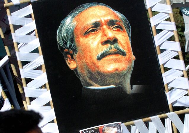 A Bangladeshi man looks at portraits of Bangabandhu Sheikh Mujibur Rahman (File)