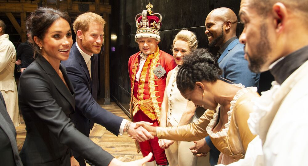 Britain's Prince Harry, Duke of Sussex, (2L) and Britain's Meghan, Duchess of Sussex (L) meet members of the cast and crew backstage after a gala performance of the musical 'Hamilton' in support of the charity Sentebale at the Victoria Palace Theatre in London on August 29, 2018