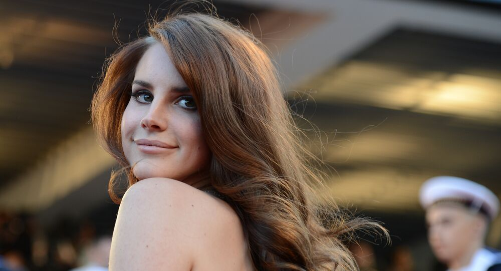 US singer Lana Del Rey poses on the red carpet before the screening of Moonrise Kingdom and the opening ceremony of the 65th Cannes film festival on May 16, 2012 in Cannes.